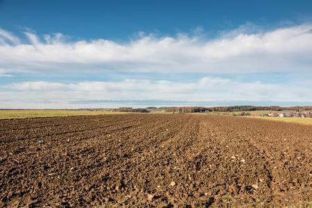 Fertile fields and green and brown soil Standard-Bild