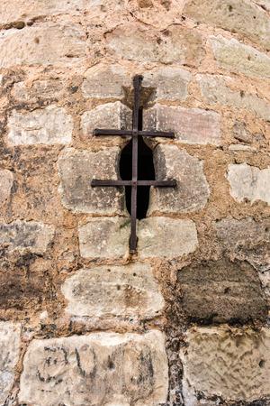 Emprasure in a big wall of the cloister Standard-Bild