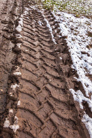 Tire track in the muddy ground