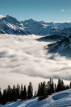 Snow on the top of the mountains and fog down the valley Stock Photo