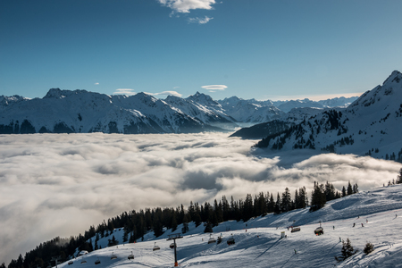 Snow on the top of the mountains and fog down the valley Archivio Fotografico