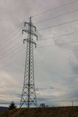 Power pylon on the green field Stockfoto