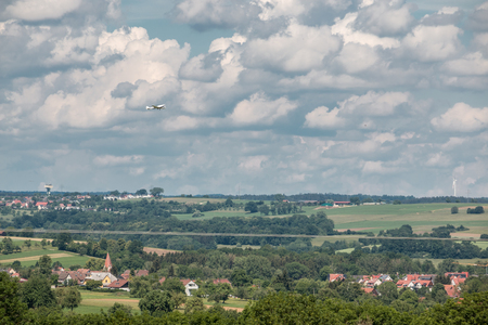 Little plane approaching and the green german countryside Stock Photo
