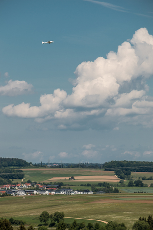 Little plane approaching and the green german countryside Banque d'images