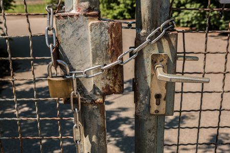 Closed gate with big steel chain and padlock