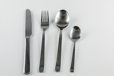 Cutlery with knife, fork, table spoon and little spoon