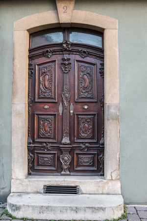 Old door of a historical building with stairway and house number Stock fotó