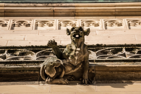 Stone gargoyle on the roof of an old historical building Stock Photo