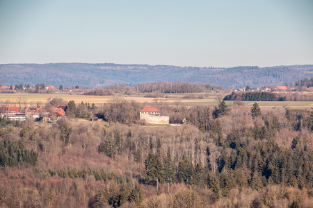 Little village and little castle in the middle of the german countryside with forests, fields and meadows Stok Fotoğraf