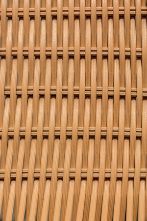 Beige wattled structures of garden chairs for background