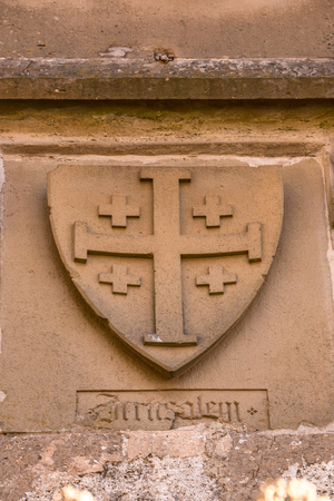 Beautiful medieval coat of arms made of yellow stone Stock Photo