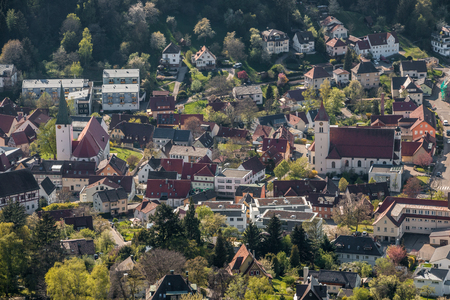 Little village in the middle of the german countryside with a church and half-timber houses and green trees Stock Photo