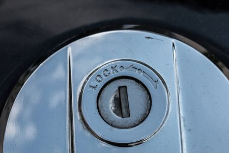 Black fuel tank of a motorbike and lock