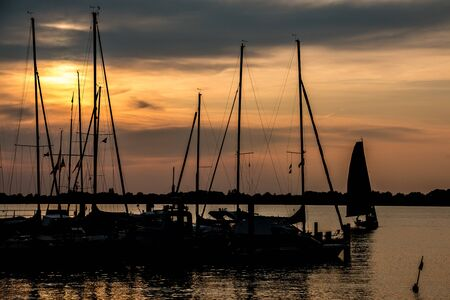Little save haven with sailboats and a golden sunset