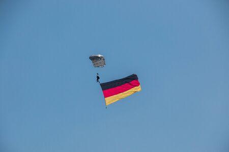 German skydiver in the air with German flag Foto de archivo - 130809333