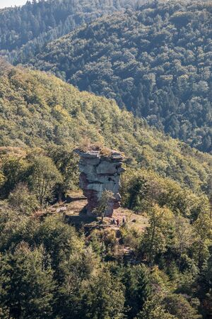 Big hill with a big rock and the green forest and the civilization Banco de Imagens