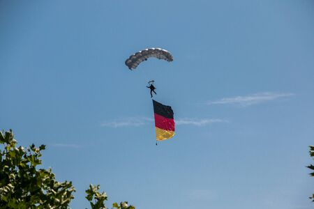 German skydiver in the air with German flag