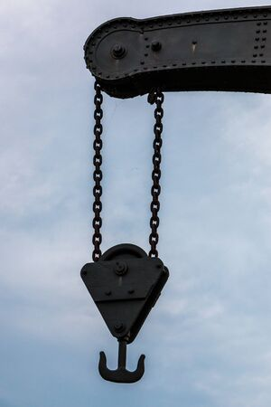 Old crane with chains made of steel Banco de Imagens
