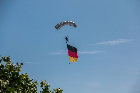 German skydiver in the air with German flag Foto de archivo - 130809160