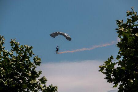 German skydiver in the air with German flag
