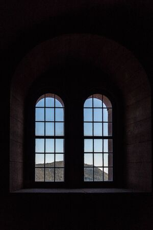 Windows of an old castle made of sandstone