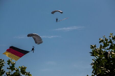 German skydiver in the air with German flag Foto de archivo - 130807644