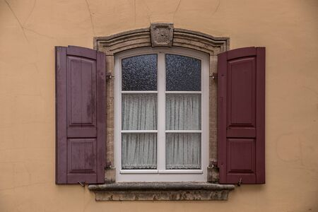 Old window of an old historical building of the town