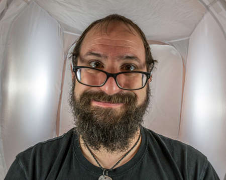 A silly looking bearded man with glasses Standard-Bild