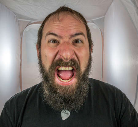 A bearded, shouting and angry looking man Standard-Bild