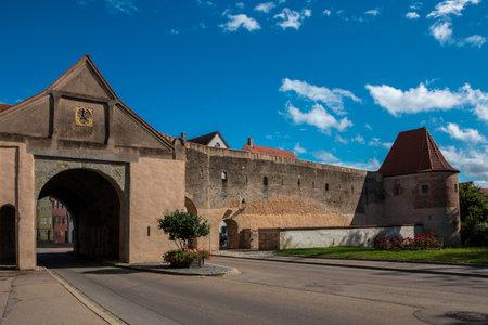 Big city gate through the big medieval city wall Standard-Bild