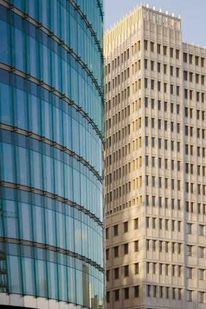 offiice: two modern office bulidings. one classic, the other in glas construction Stock Photo