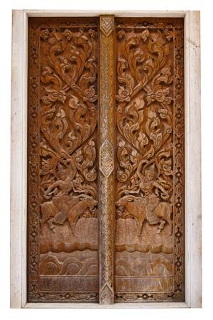 ancient wood carvings door photo