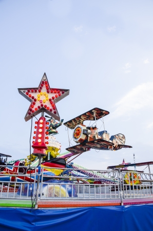 toy plane carousel in amusement park on weekend photo