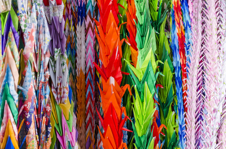 japanese children: colorful of Paper cranes. Japanese children make cranes from origami to remember the children victims of the nuclear attack.