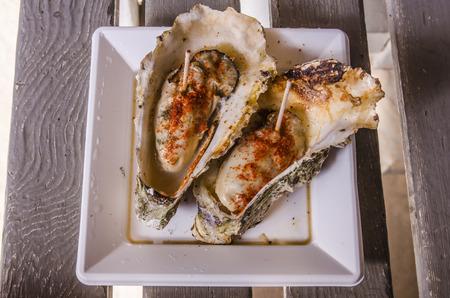ostracean: big oysters at miyajima, japan. Stock Photo