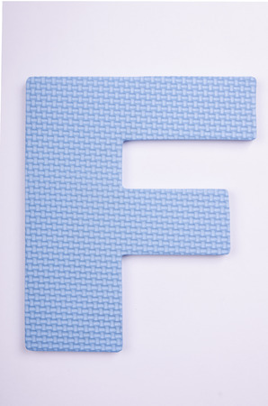 alphabet F made from foam on white background