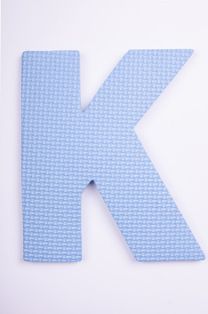 alphabet K made from foam on white isolated