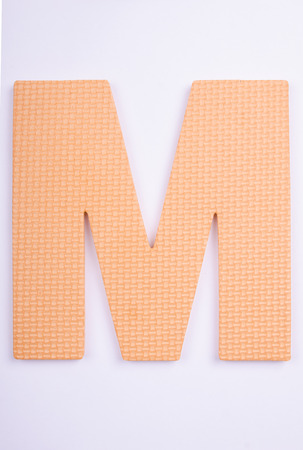 alphabet M made from foam on white isolated Stock Photo