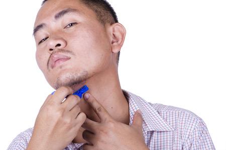 asian mans shaving
