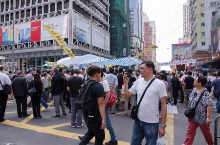 HONG KONG, OCT 15: protesters stand listening to speech in Mongkok on 15 October 2014.People protest for urban development  and mainland china policy to hong kong. more people join the protest
