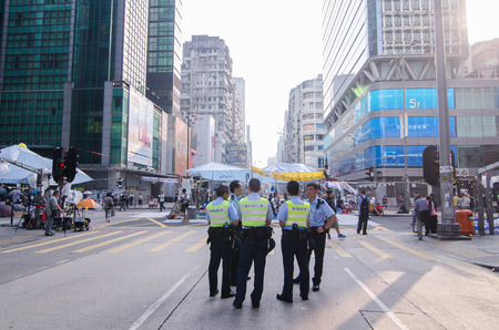 HONG KONG, OCT 16: Hongkong police bewara a many protesters in Mong Kok on 16 October 2014. during Umbrella revolution, they will control protest do not make illegal. Editorial