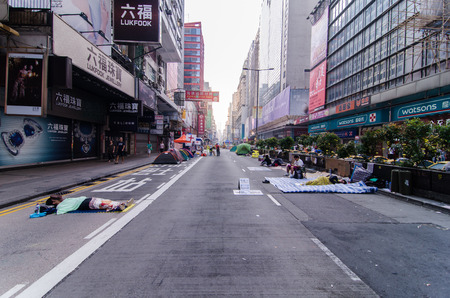 HONG KONG, OCT 16: young protesters sleep on the nathan road in Mong Kok on 16 October 2014. they rest in the morning after protest during all night.