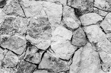 black and white stone wall, for background or taxture.