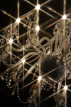 A chandelier with bulbs emanating light with a star shape Stock Photo - 9816882