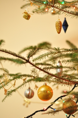 Christmas tree decorated with toys and sparkling garlands, bokeh photo