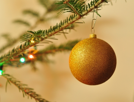 New Year background, Christmas tree with golden balls and shiny garlands photo