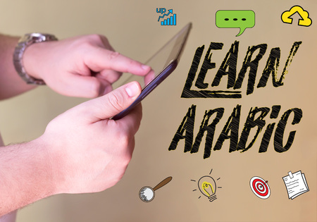 Learn arabic person holding a smartphone
