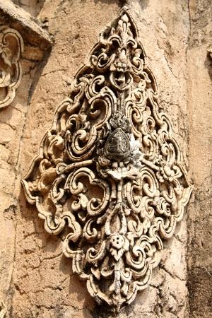 Stucco decorated corner pillars,old thai art  photo