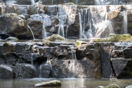 Small water fall with big rocks that have not much water in this season