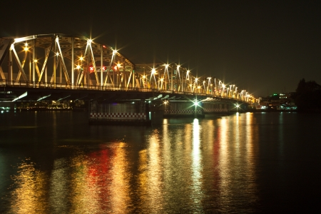Krung Thon Bridge  is a bridge over the Chao Phraya River in Bangkok, in Thailand, connecting the districts Dusit and Bang Phlat  The bridge has 6 spans, and consists of a steel superstructure resting on concrete piers